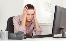 A stressed busnesswoman looking to camera Stock Photos