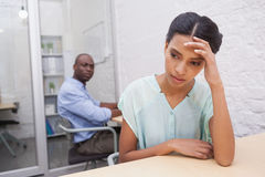 Stressed casual businesswoman with coworker behind him Stock Images