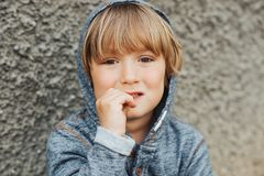 Outdoor portrait of handsome little boy royalty free stock photography