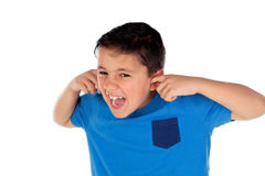 Stressed child covering his ears Stock Photo