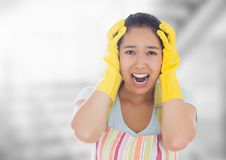 Stressed cleaning lady against bright background Royalty Free Stock Image