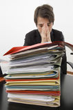 Stressed clerk. A stressed clerk tired of his job royalty free stock photography