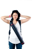 Stressed college girl with backpack and blueprint carrier Stock Photography