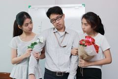 Stressed complicated relationship between three people. Love triangle concept. Stressed complicated relationship between three Asian people. Love triangle royalty free stock photos