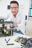Stressed computer engineer showing broken fan Royalty Free Stock Photo