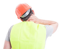 Stressed constructor feeling tired and having neck pain Stock Photo