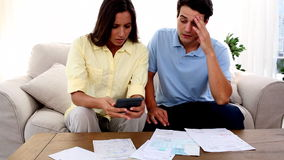 Stressed couple because of bills to pay