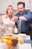 Stressed Couple in Kitchen Late for Work Royalty Free Stock Photography