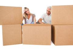 Stressed couple looking at moving boxes Stock Photos