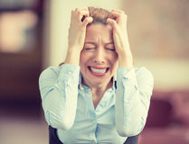 Stressed crying screaming woman in corporate office. Urban life style job stress Stock Photos