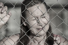 Stressed Crying woman at prison fence Royalty Free Stock Photography