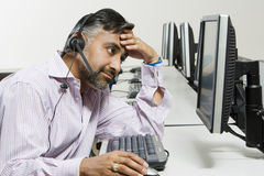 Stressed Customer Service Operator On Call Royalty Free Stock Photography