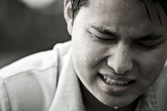 Stressed and depressed asian male. A stressed and depressed young asian male in black and white Stock Image