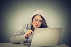 Stressed displeased worried woman sitting in front of laptop computer Stock Images