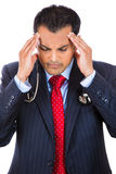 =stressed doctor-businessman with headache Royalty Free Stock Image