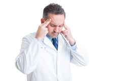 Stressed doctor or medic suffering a headache Stock Photo