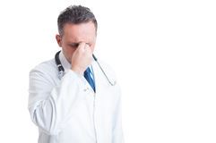 Stressed doctor or medic suffering a migraine Stock Images