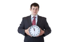 Stressed, drepressed businessman holds clock Royalty Free Stock Photo