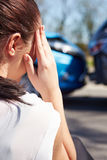 Stressed Driver Sitting At Roadside After Traffic Accident Royalty Free Stock Images