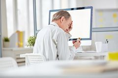 Stressed and tired office worker Royalty Free Stock Image