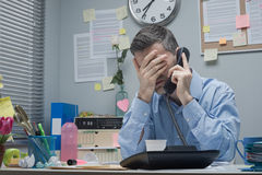 Stressed employee on the phone Stock Photos