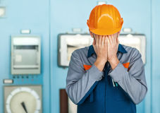 Stressed engineer closed face by two hands Stock Photography