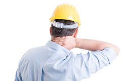 Stressed engineer feeling back neck pain Royalty Free Stock Photography