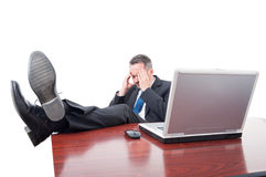Stressed executive ceo sitting in his office Royalty Free Stock Photo
