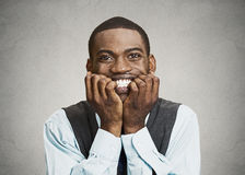 Stressed executive man biting fingernails Stock Images