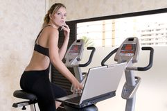 Stressed executive woman doing exercise working Royalty Free Stock Photography
