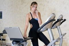 Stressed executive woman doing exercise working Stock Photography