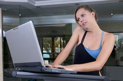 Stressed executive woman in the gym with lap top Stock Images