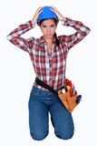 Stressed female builder Stock Photo