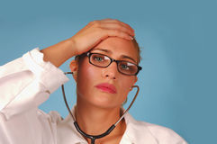 Stressed female doctor Stock Photography