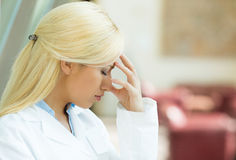 Stressed female doctor Stock Image