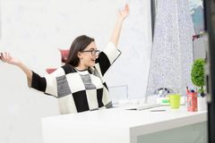 Stressed female freelancer screaming in shock, having serious computer problem. Horrified student girl clutching her head in panic, missing graduation project Royalty Free Stock Photos