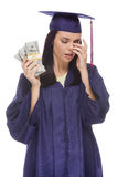 Stressed Female Graduate Holding Stacks of Hundred Dollar Bills Stock Photo
