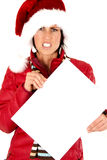 Stressed female model holding a blank sign wearing santa's hat Royalty Free Stock Photos