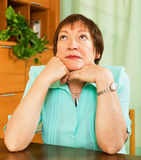 Stressed female pensioner at home Stock Images