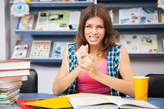 Stressed female student in a library Royalty Free Stock Images
