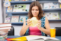 Stressed female student in a library Royalty Free Stock Image