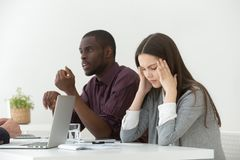 Stressed female suffering from headache during business meeting stock photos