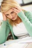 Stressed Female Teenage Student Studying Stock Photography