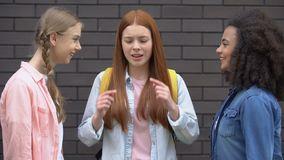 Stressed female teenager covering ears suffering classmates bullying, abuse. Stock footage stock video