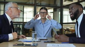 Stressed female worker covering ears feeling tired of arguing office colleagues. Stock footage stock video