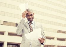 Stressed frustrated man holding looking at documents Royalty Free Stock Images