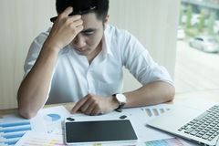Stressed and frustrated young graphic designer working with comp Stock Photos