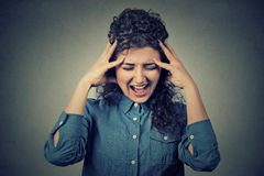 Stressed frustrated young woman yelling screaming Royalty Free Stock Photo