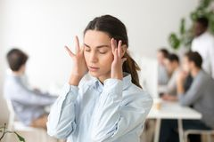 Stressed frustrated young woman employee feeling dizzy or having royalty free stock photography