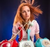 Stressed girl with phones Royalty Free Stock Image